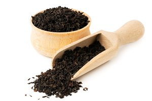 Black tea leaves in wooden plate