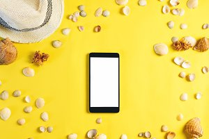 Empty smartphone on yellow summer ba