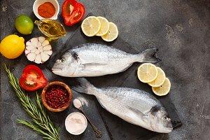 Raw dorado fish with spices on cutti
