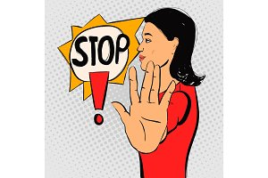 Brunette woman gesturing stop sign.