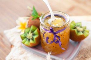 Exotic kiwi jam with ripe fruits on