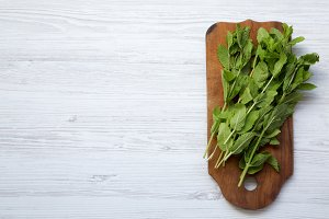 Top view, fresh mint on wooden board