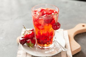 Red compote juice with fresh cherry