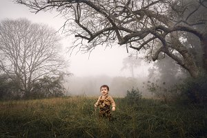 Childhood unplugged. Baby in the fog