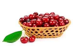 Ripe cherries in basket isolated on