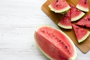 Slices of fresh watermelon on bamboo