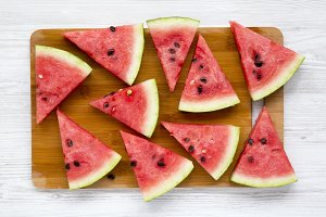 Chopped watermelon on bamboo board