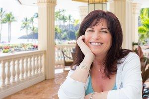 Woman Relaxing on Veranda