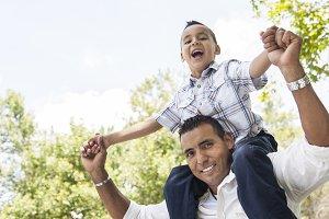 Hispanic Father and Son Having Fun i