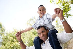 Hispanic Father and Son Having Fun i