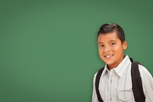 Cute Hispanic Boy In Front of Blank