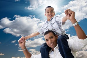 Hispanic Father and Son Having Fun O