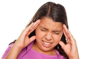 Pretty Hispanic Girl with Headache