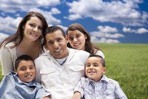 Hispanic Family Portrait Sitting in