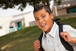 Happy Young Hispanic Boy Ready for S