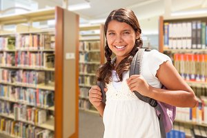 Hispanic Girl Student Walking in Lib