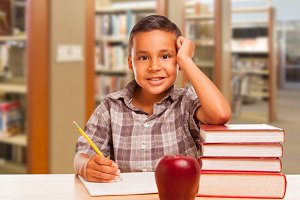 Hispanic Boy with Books, Apple, Penc