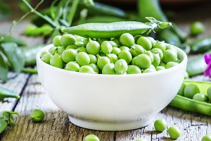 Peeled pea green peas in a white por
