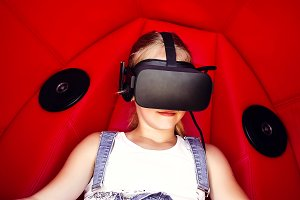 girl sitting in virtual reality dres