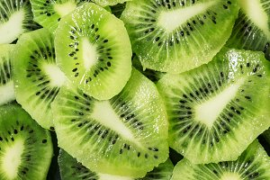Green kiwi food background, top view