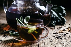 Black tea with fresh sage, glass cup