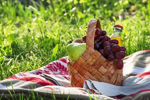 Wicker picnic basket with fruits and