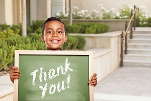 Hispanic Boy Holding Thank You Chalk