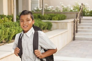 Happy Hispanic Boy with Backpack Wal