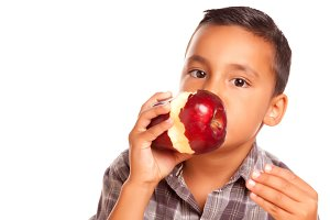 Adorable Hispanic Boy Eating a Large