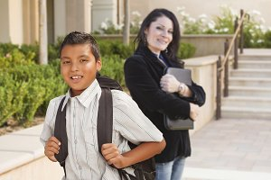 Hispanic Boy with Backpack on School