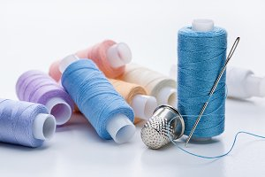 Coils with threads of pastel tones.