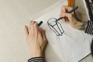 Girl fashion designer draws sketch