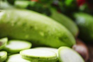 Round zucchini slices and fresh radi