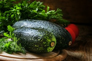 Large green zucchini, vintage wooden