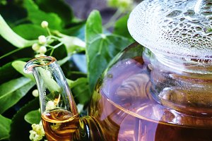 Useful linden tea in glass teapot, b