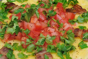Omelet  bacon slices, tomatoes