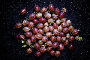 Ripe red gooseberry, dark food backg