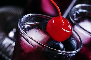 Cocktail with blueberry, cinnamon an