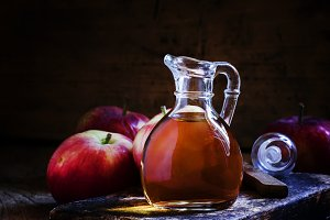 Apple cider vinegar in a glass jug,