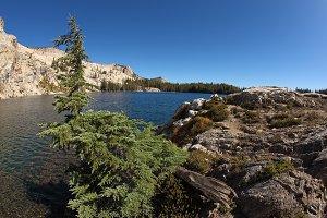 Stony coast of lake in park Yosemite