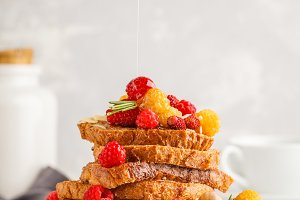 French toasts with berries and syrup