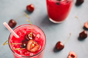 Fresh summer cocktail with cherries