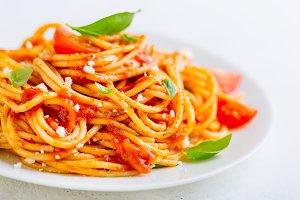 Pasta dish with tomato sauce on whit