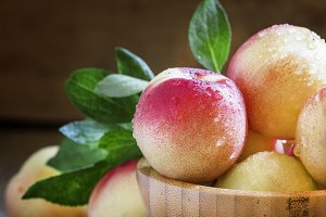 Fresh white nectarines in a wooden b