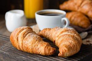 Croissants, coffee and orange juice