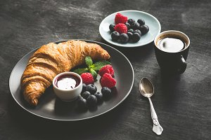 Breakfast with croissant, coffee