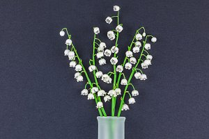 Bouquet of lilies of the valley on b