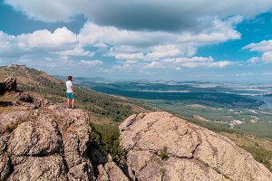 Man is standing on a mountain cliff