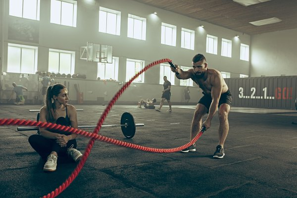 Stock Photos - Men with battle rope battle ropes