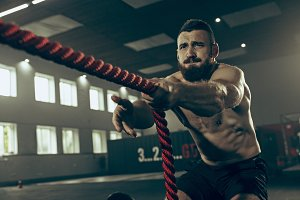 Men with battle rope battle ropes